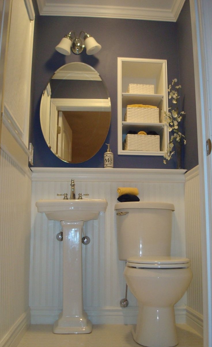 Tiny Bathroom Under Stairs As Space Saving Design With Unique Wall