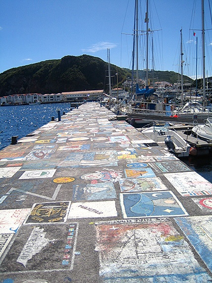 """Horta Harbour, Faial: """"As you return to town and pass the harbour, pause to view the drawings and cartoons on the walls left by visiting yacht crews. This free outdoor art gallery exists because it is said to be bad luck to sail away without leaving your mark."""" Azores: The Bradt Guide www.bradtguides.com"""