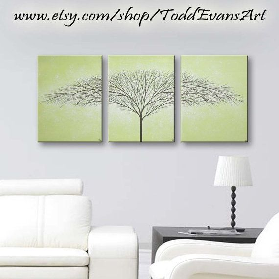Organic modern art is the in decorative style. Now, my original hand painted trees are the unique signature wall art to make your home decor pop! Like a snowflake, every set is unique and one-of-a-kind!  ★ Retail $149 ★  ★ Hand painted by Todd Evans  ★ Original Acrylic Painting. (Not a print.)  ★ 3 Piece hand painted set  ★ Sage green background with white glow  ★ Black Silhouette trees  ★ Matte Finish  ★ 36x16 inches total - Three 12x16 panels - 1 Thick  ★ Approximate metric measurements…
