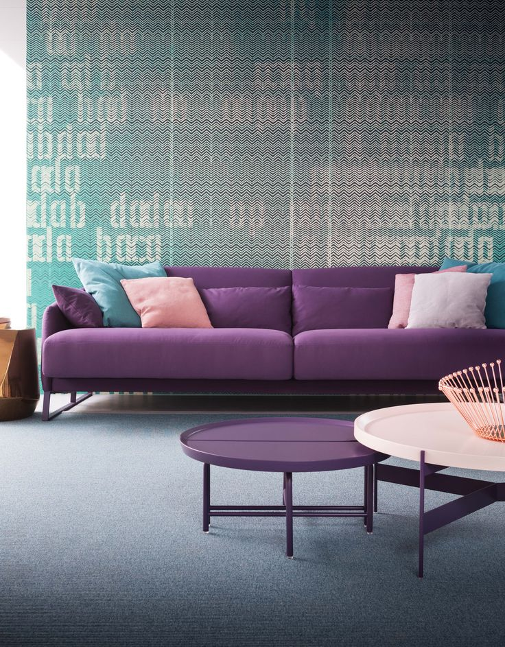 Purple Sofa with Blue and Pink accents. Available at Hold It Contemporary  Home in San Diego.