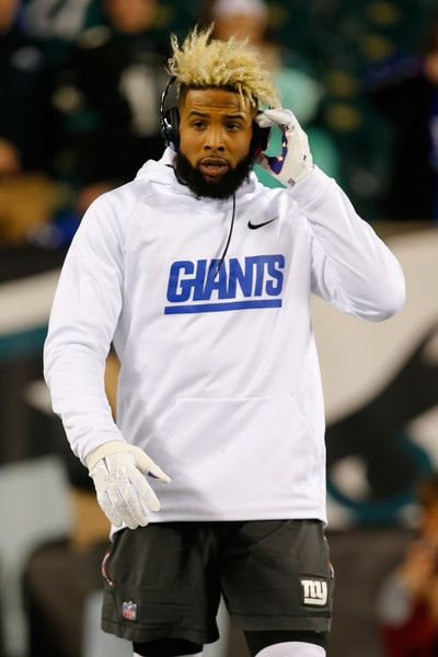 Odell Beckham Jr Photos Photos - Wide receiver Odell Beckham Jr. #13 of the New York Giants looks on during warm-ups prior to the game against the Philadelphia Eagles at Lincoln Financial Field on December 22, 2016 in Philadelphia, Pennsylvania. - New York Giants v Philadelphia Eagles