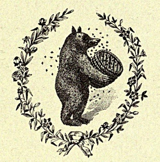 Vintage Ephemera: animals_Bear with a beehive surrounded by a wreath_engraving 1916