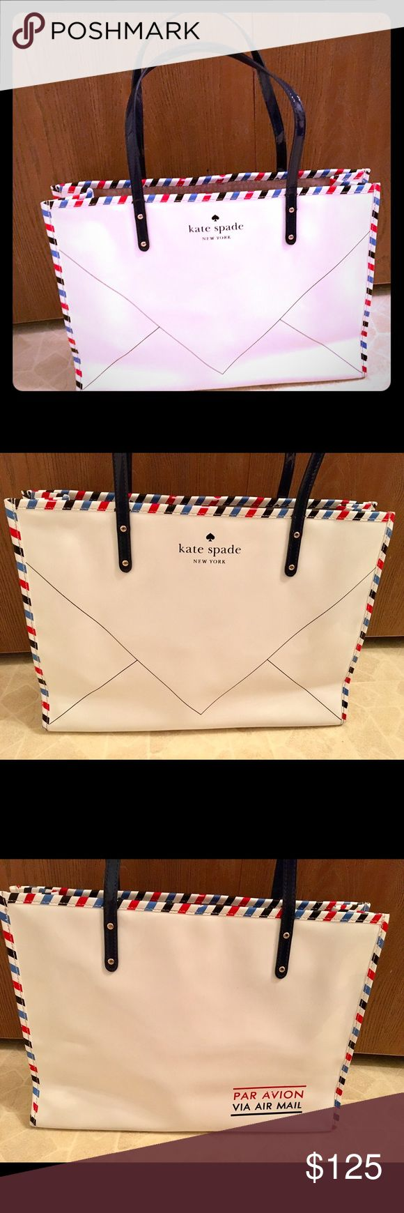 """Rare Kate Spade Par Avion Air Mail Envelope Tote This is a beautiful rare Kate Spade tote. In excellent condition. Only sign of wear are a couple of spots on the AV in the word AVION.  Otherwise in excellent condition.   Shoulder tote bag crafted in patent pvc. Front Kate Spade New York Envelope Graphic. Back """"Par Avion Via Airmail"""" graphic. Red white & blue striped border. Open top. Custom lining w interior zip and double slide pockets 15.5""""W x 11""""H x 5""""D drop length: 10''. kate spade Bags…"""