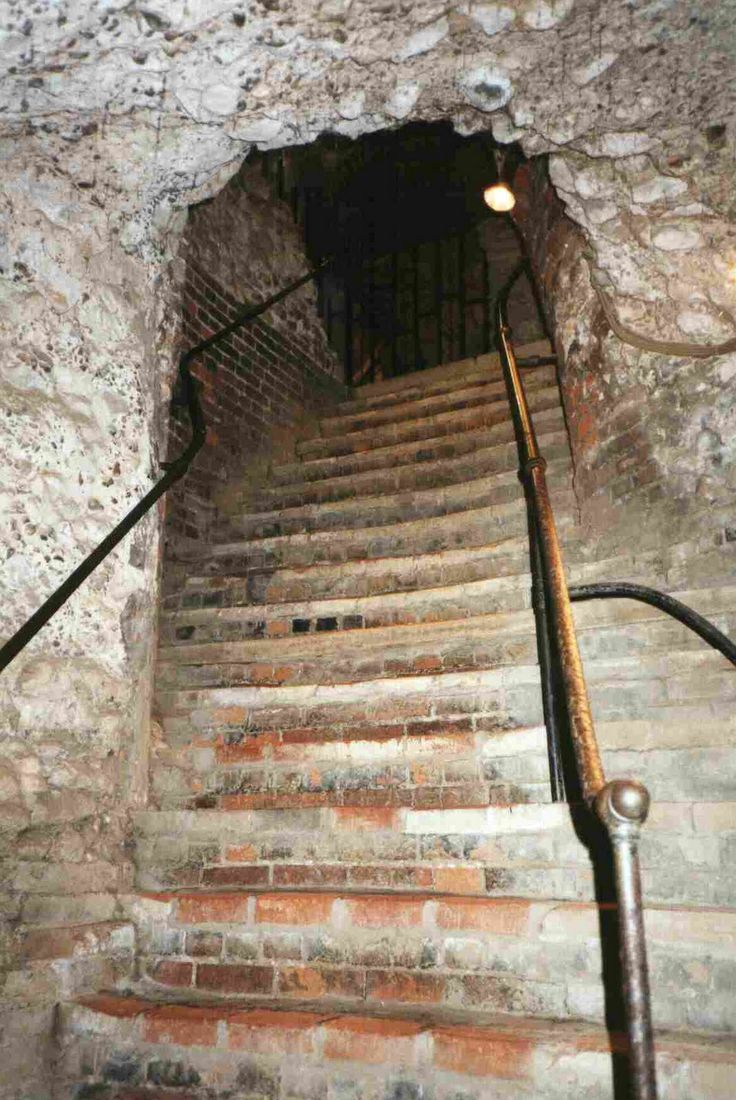 Steps leading from the Roman Vaults in Colchester Castle, Essex, England. The…