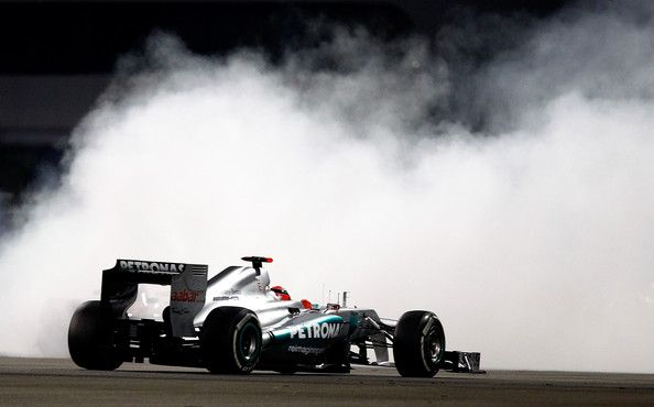 Michael Schumacher of Germany and Mercedes GP passes by Felipe Massa of Brazil and Ferrari who spinned during the Abu Dhabi Formula One Grand Prix