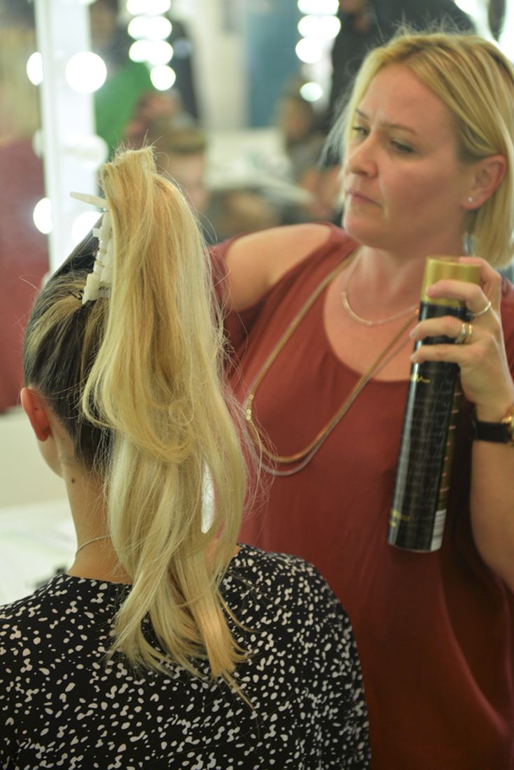 Bettjemans senior stylist Amber Evans creating high cascading ponytails for Trelise Cooper's Theatre of Fashion, 2016
