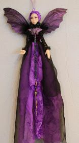 These are hanging Half Dolls. They are sculpted from Puppen Fimo and dressed in hand dyed silk gauze. The doll with the orange fabric has a...