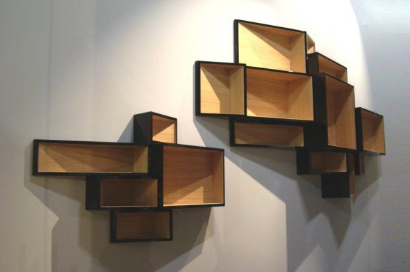Book shelf designed by Dutch designer Ka-lai Chain as a cluster of uneven boxes.