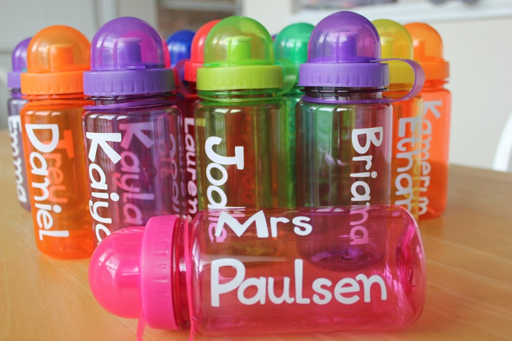 I wanted to do something fun for my daughter's classmates to give them on the last day of school, so I found these adorable water bottles at my local craft store. I personalized each one by cutting out vinyl letters with my Cricut. I filled each with a pair of sunglasses, a rubber swim duck, and water guns for the boys and bangle bracelets for the girls. (You could also add a small bottle of suntan lotion.) I wrapped them up in a cello bag with a pretty ribbon - which made for an adorable…