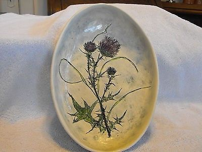 This is a handcrafted decorative hanging bowl by Salt Marsh Pottery, Dartmouth Mass. The back of the bowl is marked  Thistle , MT88, Salt Marsh Pottery, Dartmouth Mass. Great piece. No chips or cracks