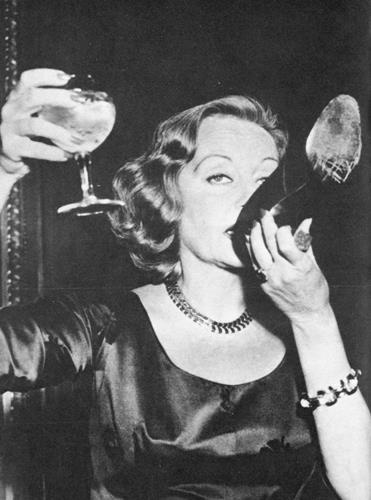 Tallulah Bankhead demonstrates how decadent and extravagant old Hollywood was. Drinking Champagne out of her shoe! At the Ritz- where else?!