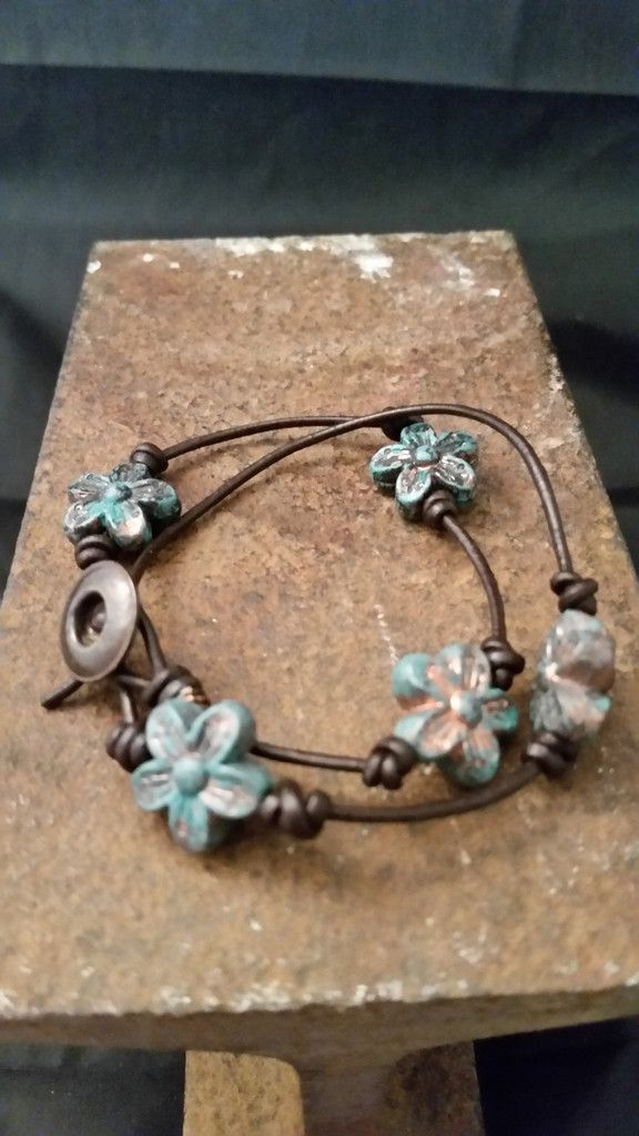 Double wrap knotted leather floral accent bracelet