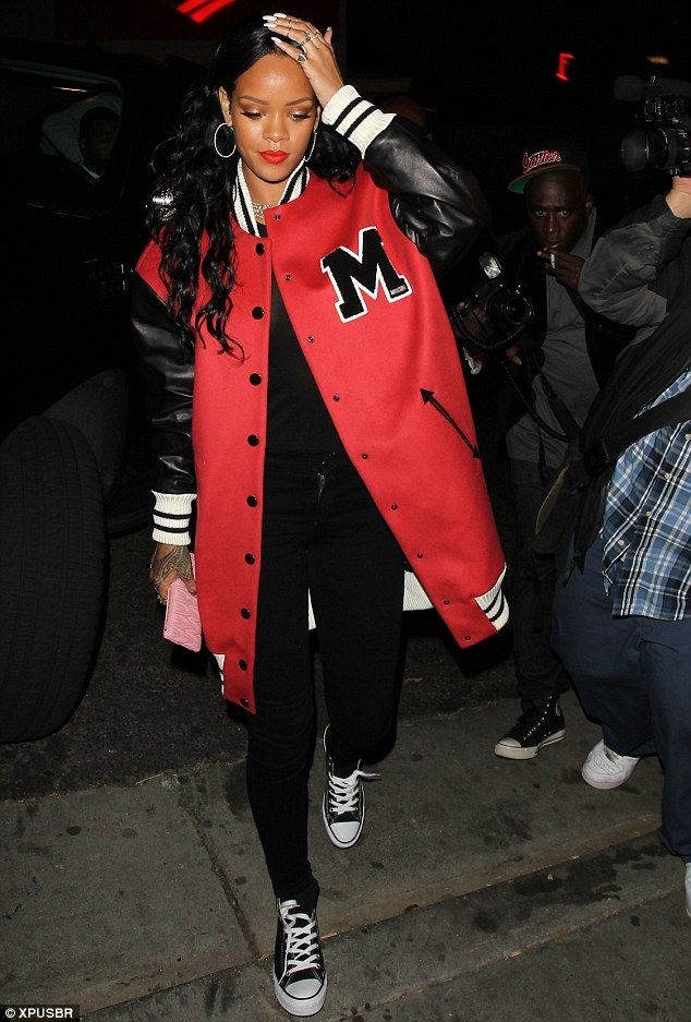 Street style: Rihanna rocked her usual casual attire with lashings of red lipstick to matched her oversized baseball jacket