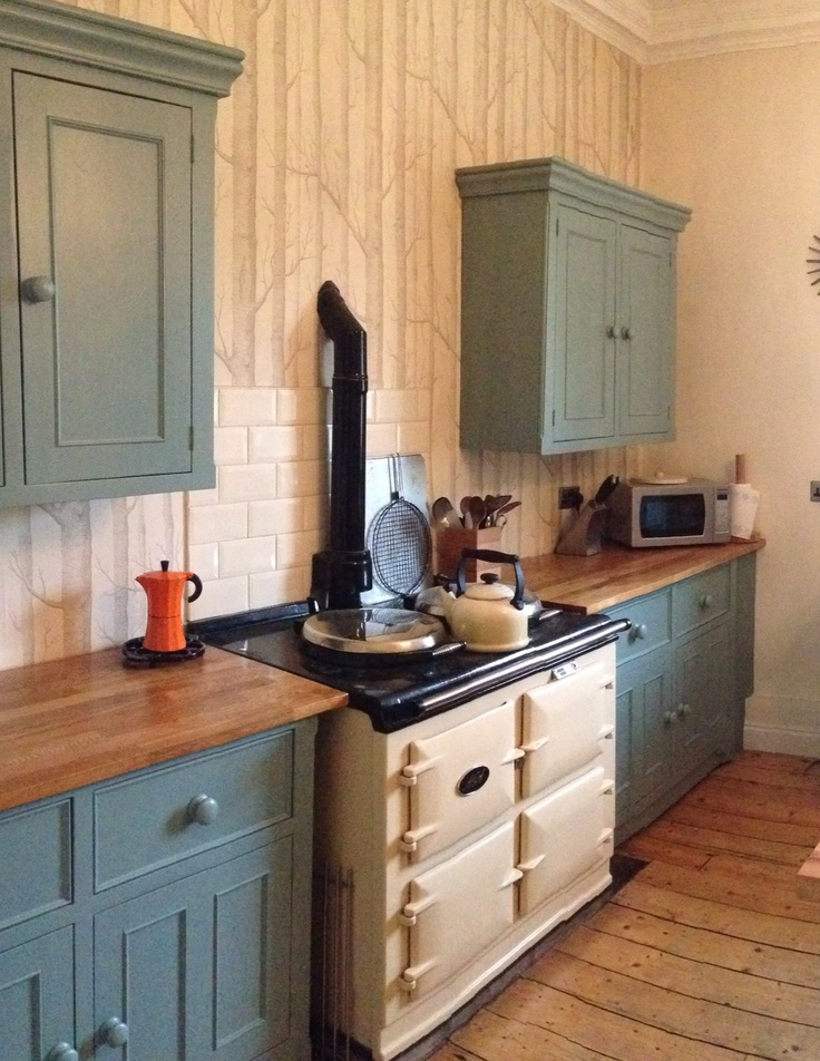 The Kitchen - and what every home should have - an Aga! The hand made wooden kitchen is finished in Farrow & Ball's Oval Room Blue