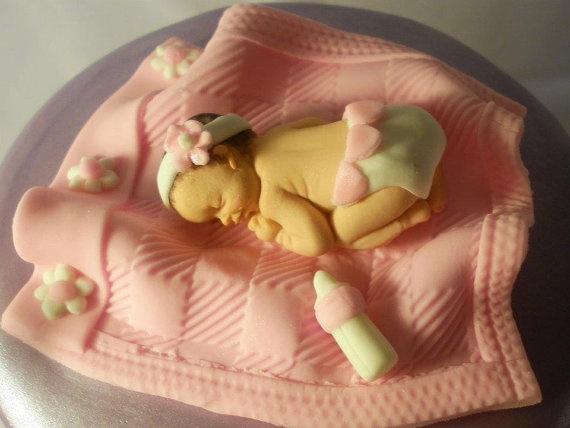 Fondant baby girl cake topper.
