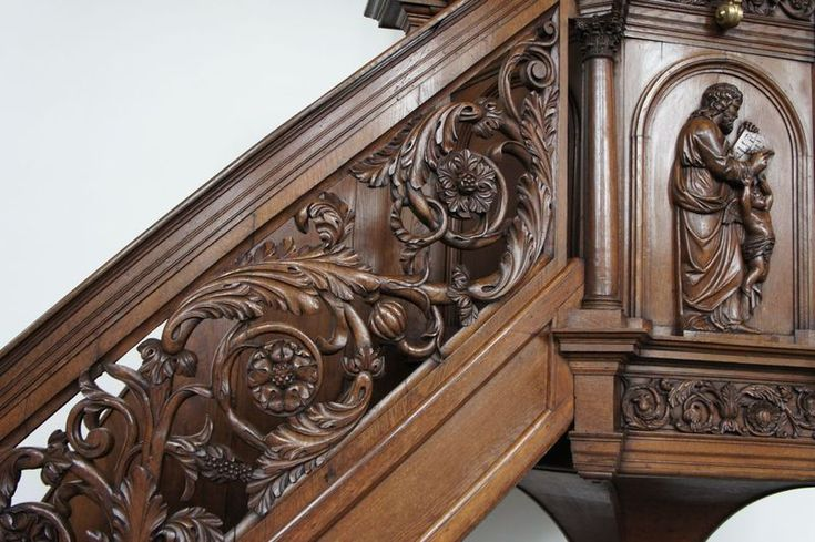 acanthus leaf hand-carved in a walnut pulpit