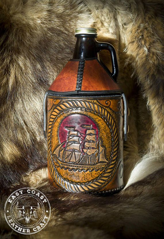 Nautical Ship Leather Growler Bottle Carrier  #growlerbottle #craftbeer #beercozy #bottlecozy #nautical #pirateship #leathercozy #growlerholster #growlercarrier #leathergrowlerholder #beerjug #moonshinejug #leathercraft #customleather #etsy #baraccessories#minibar #mancave #picaroons
