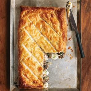 Taleggio and mushroom pastry melt recipe. The combination of creamy cheese and rich mushrooms makes this an indulgent snack recipe no one could refuse.