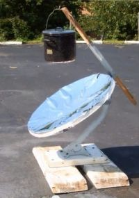 How to Make a Parabolic Solar Cooker.  Survival Doc of The New Survivalist web site demonstrates how to make a parabolic solar cooker from an old satellite dish.