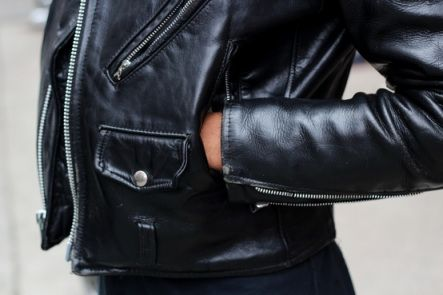 How to break in a leather jacket: Wear it in the rain! Water will soften up the leather and allow it to stretch and conform to your body.