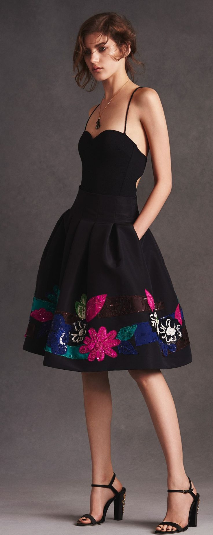 Love the length of skirt and long torso...black with pops of color are great too!