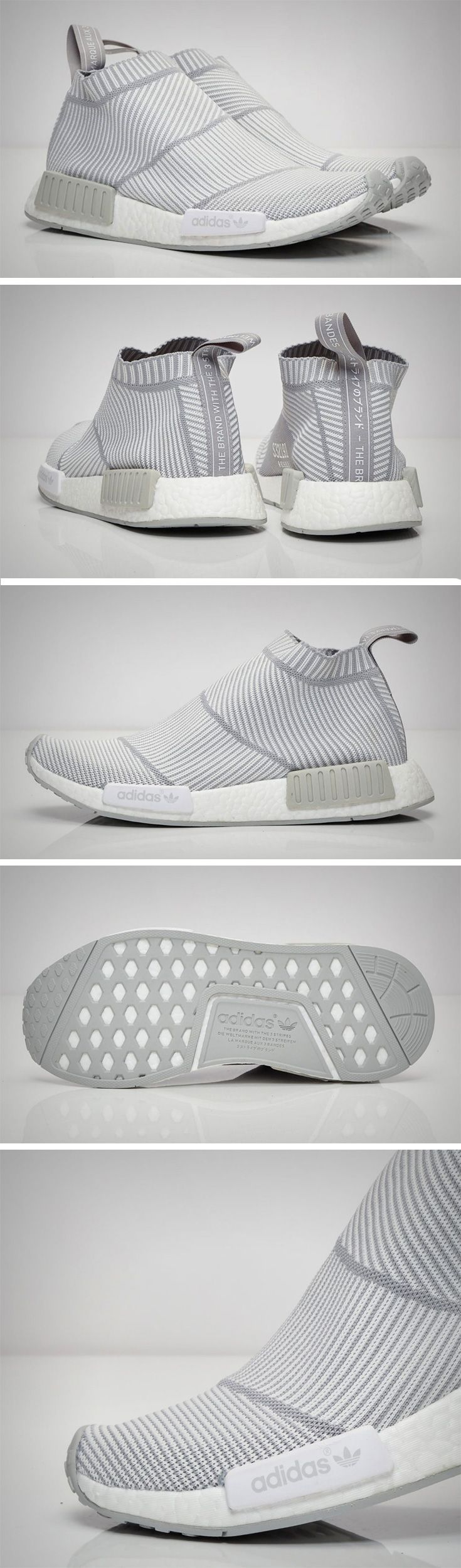 "The latest from Adidas Originals is an NMD tribute to minimalism that combines the best of Primeknit and Boost! Called the ""NMD City Sock"", this urban style/runner hybrid footwear features a Primeknit upper sock-like strap construction that wraps the foot in adaptive support and ultralight comfort as well as a Boost sole offers ultra-responsive cushioning. In a dual tone white and grey combination, this pair is aesthetically on point for summer!"