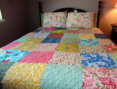"""It's simply 12"""" squares - nothing complicated. I just needed something that would come together fast and easy. I picked out all the springy and bright fabrics. It measures approximately 92x92""""."""