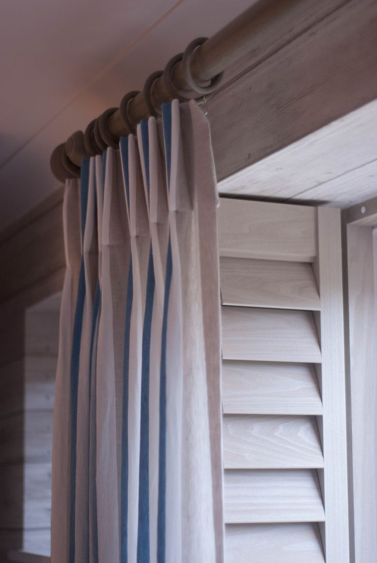Layered window treatments - the only way! Louvred plantation shutters with voile curtains