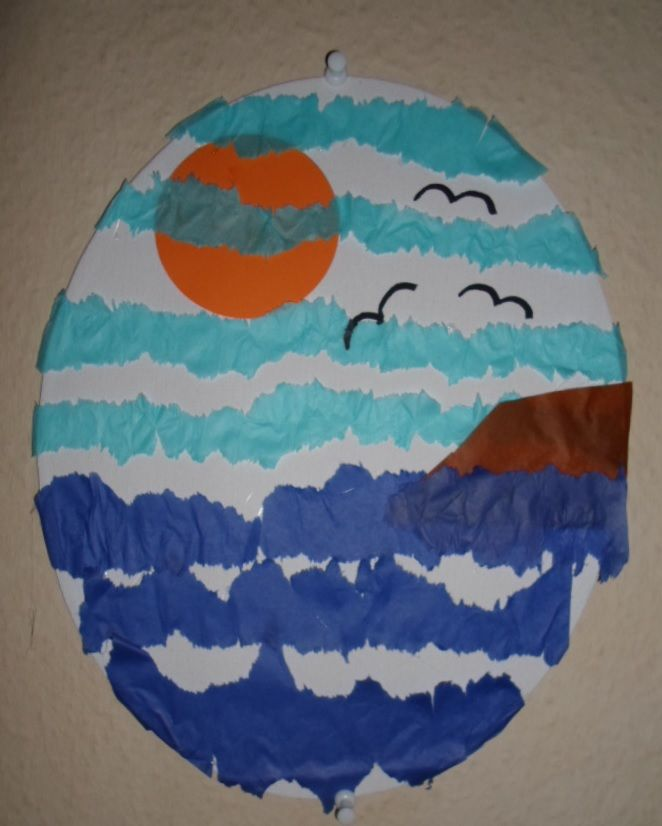 Sky/ocean collage. The sun is made out of cardboard, the birds are painted on, the rest is made out of tissue paper.