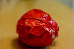 Bible Memory Verse Game: Unwrap the Ball. Alternative idea to teacher calling a key passage: child gets to unwrap & 'call' the next key passage. Play sitting in a circle on the floor with bibles in laps. Include the reference if key passages are not yet memorized by all.