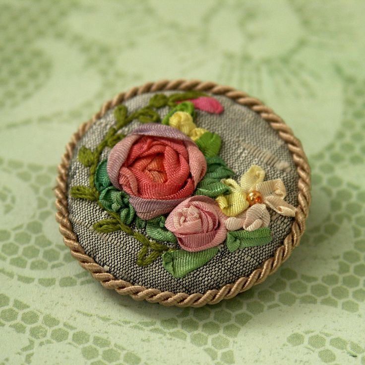 Brooch with silk ribbon embroidery on silver silk dupion.