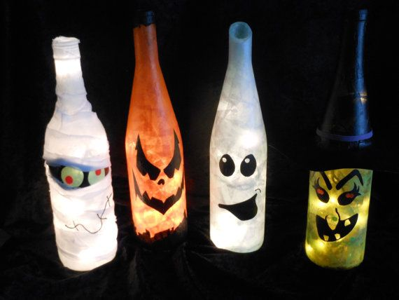 We have drilled a hole in the back of the wine bottle to insert the string of lights, then creatively decorated with tissue paper and paint. They will never get too hot to touch and being covered completely with Mod Podge they are less likely to break and are water resistant. Jack O Lantern, Ghost, Mummy, and Witch are avaliable. Email for special requests.