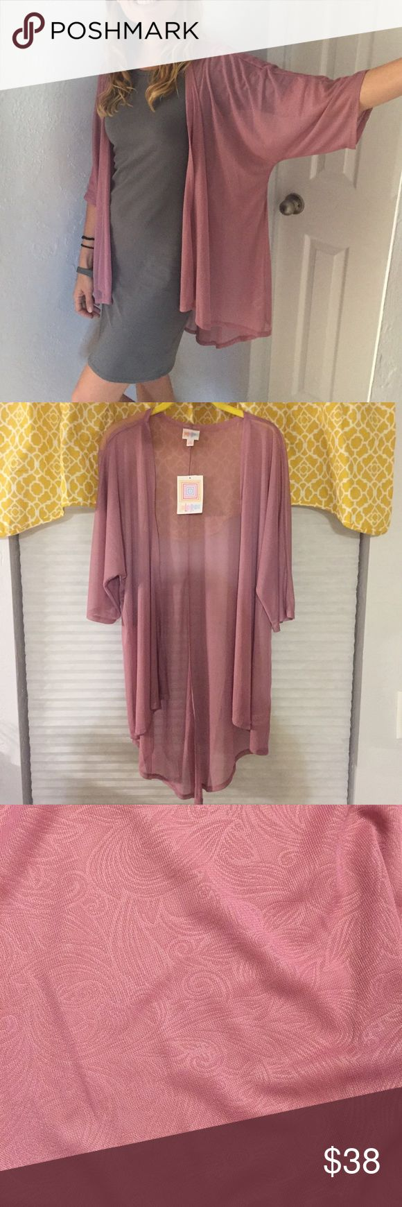 Beautiful sheer Lindsay kimono, new with tags! Pretty mauve color LuLaRoe Lindsay kimono. Sheer mauve with a lovely swirly flower pattern. Only tried on! I love this, it's just not my color. 😕 Dresses up any outfit! Leave loose or tie at the waist. LuLaRoe Tops