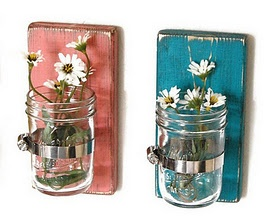 Hanging vases made out of mason jars.
