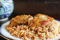 Arroz Con Pollo ~ Classic dish of Spain and Latin America, this arroz con pollo recipe is browned chicken cooked with rice, onions, garlic, and tomatoes. ~ SimplyRecipes.com