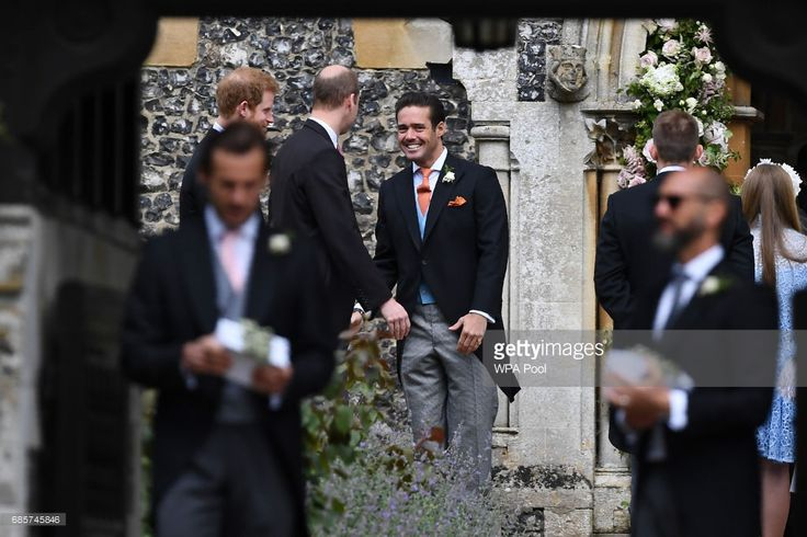 Spencer Matthews (C), brother of the groom, greets Britain's Prince William, Duke of Cambridge, and Britain's Prince Harry (L) as they attend the wedding of Pippa Middleton and James Matthews at St Mark's Church on May 20, 2017 in Englefield Green, England.