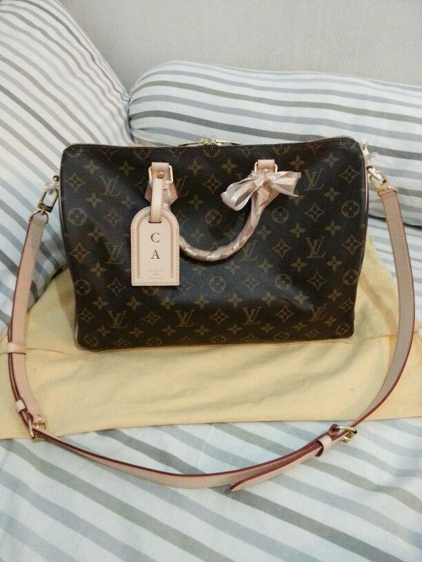 1d2368476e29 My very own Louis Vuitton Speedy Bandouliere 35 in Monogram with  personalized luggage tag
