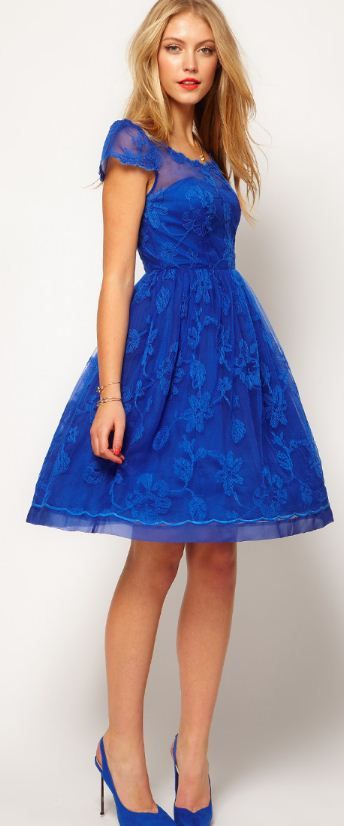 I like the blue colour of this dress and the lace overlay.  I would want it to be longer.