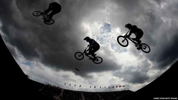 Exhibition riders perform on Day 12 of the London 2012 Olympic Games at the BMX Track in London, England.