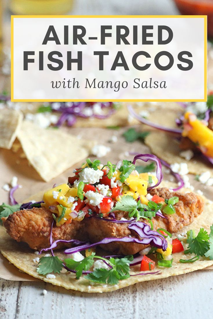 These air-fried fish tacos are beer battered in Corona and served with a delicious mango salsa | the INSPIRED home