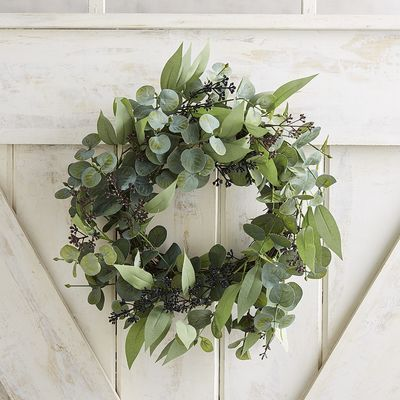 Gathering the fresh colors and textures of eucalyptus in a circle of abundance, our wreath creates a focal point of beauty and confidence for your door or mantel. Hang up, hang out—it's all good.