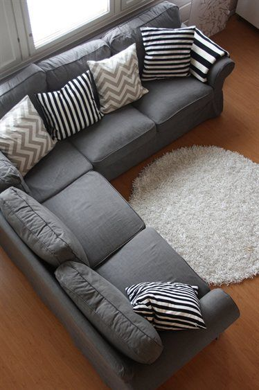 grey couch with cool pillows. could also add some accent color pillows. Loving the color combo on this sofa and pillows. simple yet effective patterns, reminds me of wabi sabi