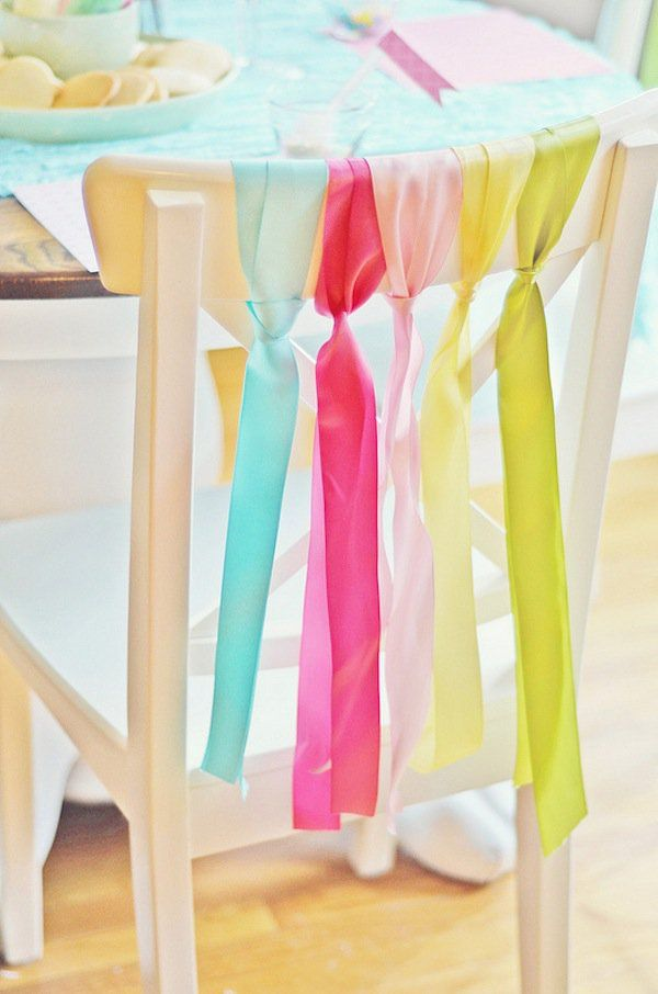 Tie the ribbon to the backs of the chairs. It's a simple yet effective way to decorate dining room chairs for your Easter spring party.