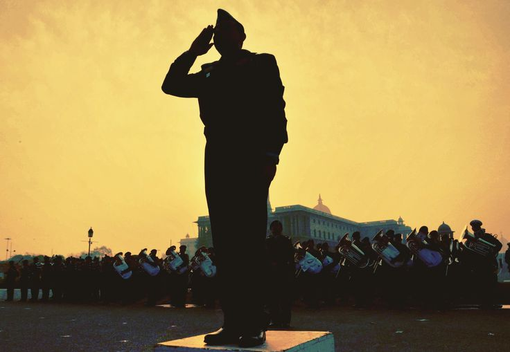 Silhouette Soldier Saluting A Colorful Nation INDIA,, A Silhouette image of An Indian Army Soldier saluting the National Flag of India Tiranga during beating retreat ceremony at Raisina Hills in New Delhi..