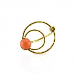 Circle Ring Pink Coral - 18 carat gold and 0.01 W / SI diamond. Danish Design. From Trine Trier's Circles series comes this beautifully light and vibrant ring. The band and top circles are 17-karat gold. The pink coral and seed diamond are reminiscent of a planet and its moon or the components of an atom or molecule. This beautiful, summery piece of jewellery is the perfect accessory to brighten any outfit, either casual or formal. http://www.nuuru.com/en/circle.html