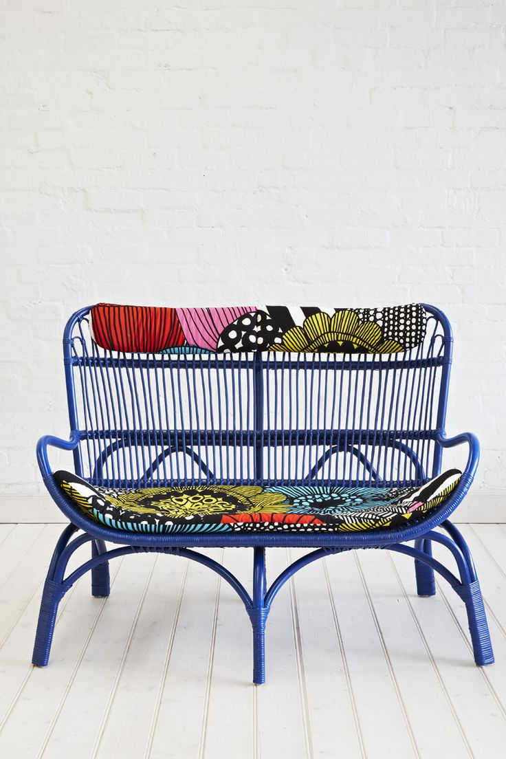 These 60's style natural loungers come with a cotton Marimekko print cushion with button detail. Perfect for an afternoon of relaxing especially with it's matching ottoman. Size is approx 68cm in width x 76cm in depth x 102cm in height. Available in other colours. Available in Natural, Black, White & Jade.