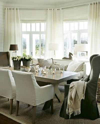 comfy cozy dining room. Love the warmth amongst all the white.