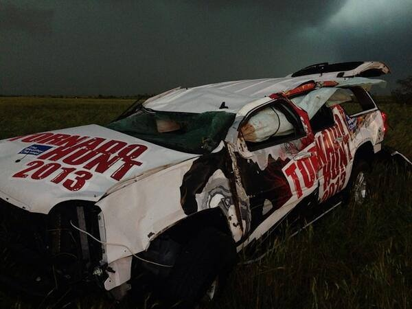 """The Tornado Hunt vehicle after being thrown nearly 200 yards by the El Reno Tornado in Oklahoma City tonight. Tornado Hunt crew and Mike Bettes are okay! Photo Credit: @SeanSchoferTVN Sean Schofer at 8:25pm. """"We stopped to help & they are OK,"""" said Schofer."""