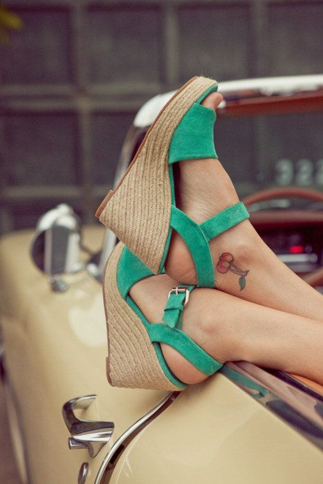 Green shoes with cherry tattoo