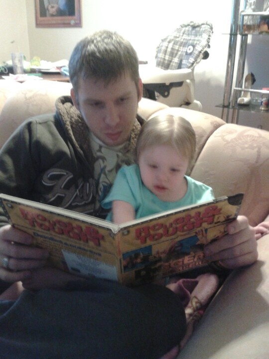 Daddy and bec reading a book before bed